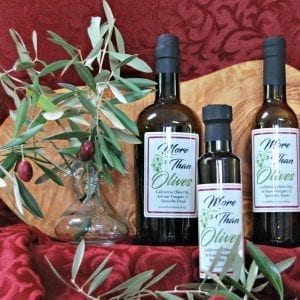 three bottles of olive oil jar and wooden bowl
