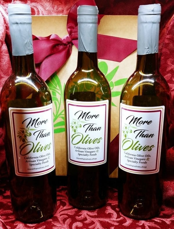 three bottles of olive oil and gift box